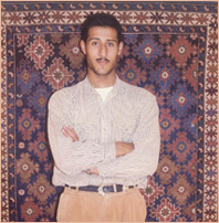 Anas at The Ajami Rug Gallery.jpg