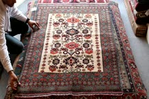 A selection of hand-woven rugs for purchase at our Gallery