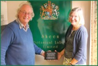 SPECIALLY COMMISSIONED PLAQUE FOR THE ORIENTAL RUG GALLERY LTD'S WEAVING