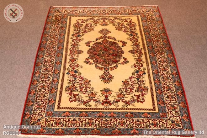 Antique Qom rug