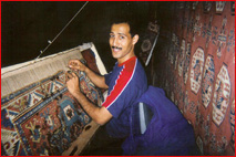 Anas restoring customer rugs at the family rug business.jpg