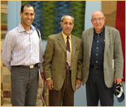 Anas with his Father and Dr David Ruben at Hali Fayre.jpg
